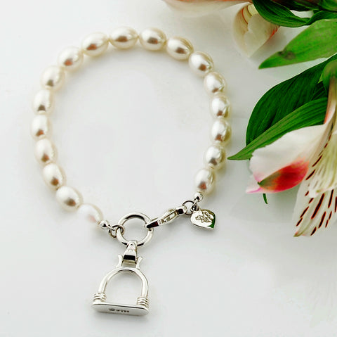 Solid silver and cultured pearl bracelet with stirrup inspired charm