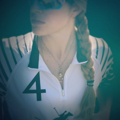 girl wearing gold, pearl and diamond polo necklace