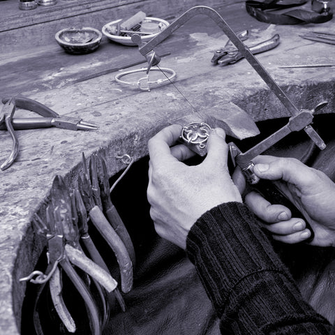 Close up of Sylvia's hands making jewellery at the bench