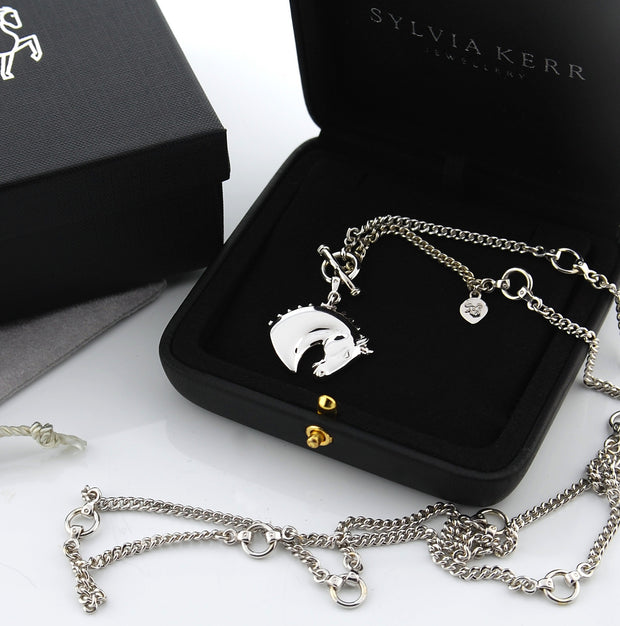 Designer white gold horsehead heavy lariat neckchain with bit detailing in presentation case.