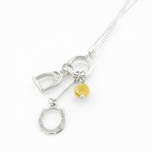 Designer solid silver horseshoe, stirrup and citrine charm necklace on white background