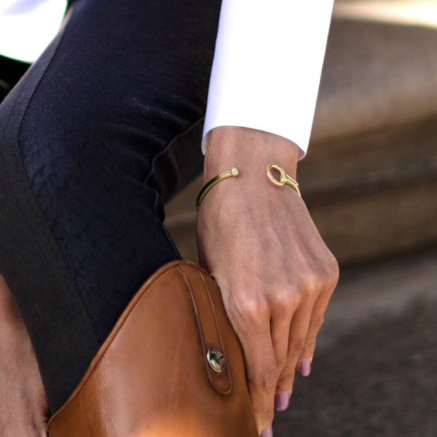 Model wearing Designer solid 9ct yellow gold torque style equestrian styled bangle.