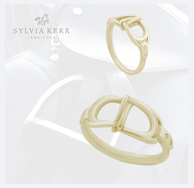 designer gold interlacing stirrup ring on saddle and stirrup background
