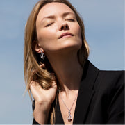 model wearing Designer solid silver vintage stirrup drop earrings with silver leather strap detail and matching necklace.