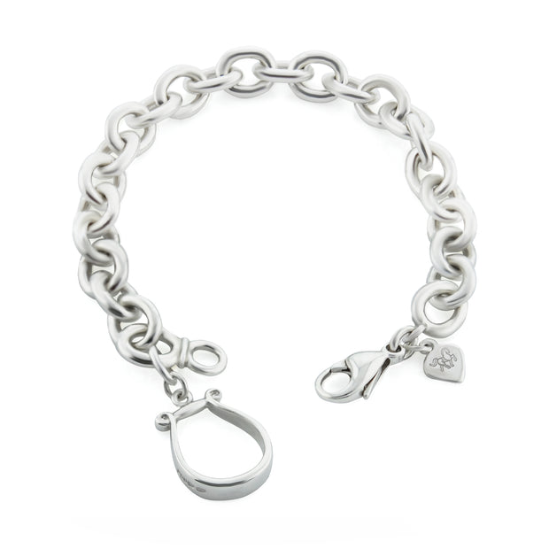 Designer solid silver western stirrup heavy chain bracelet on white background.