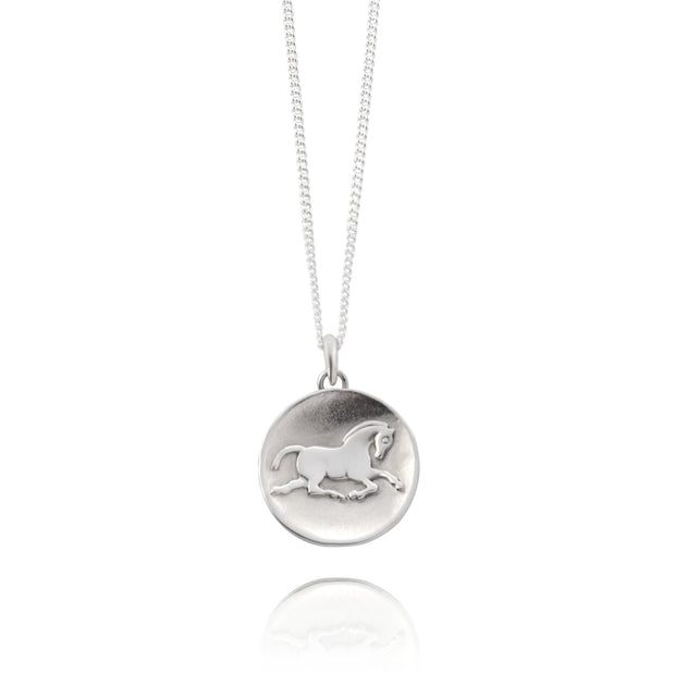 Designer solid silver horse inspired coin necklace on white background.