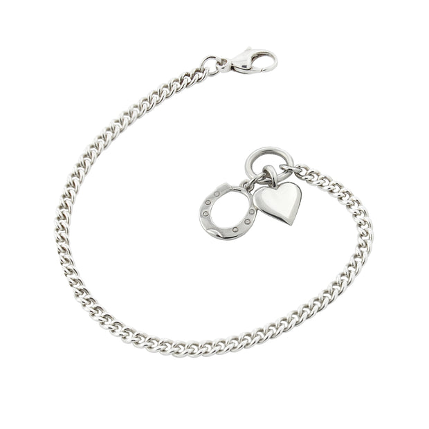 designer solid silver curb chain bracelet with heart and horseshoe charms.