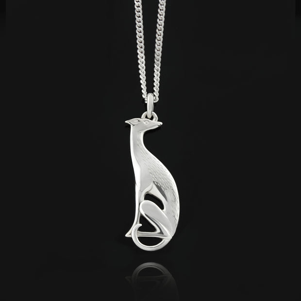 Designer solid silver hand carved hound necklace on a black background.