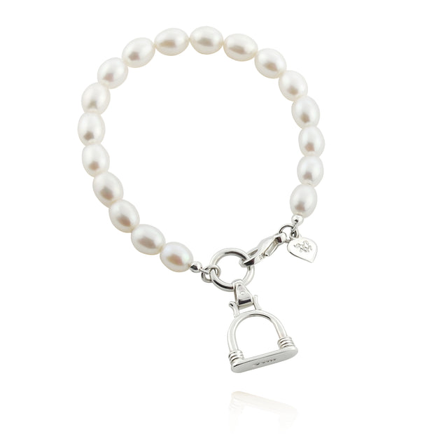 designer silver and cultured pearl bracelet with vintage stirrup charm on white background