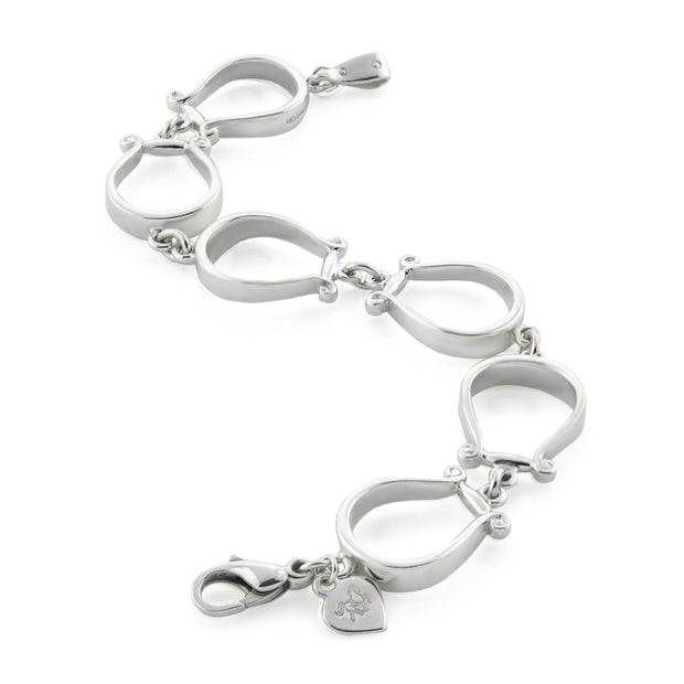 Designer six western stirrup solid silver bracelet on white background.