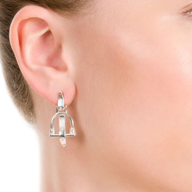 close up of model wearing  Designer solid silver vintage stirrup drop earrings with silver leather strap detail.