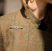 model wearing designer solid silver equestrian inspired stocpin brooch on tweed jacket
