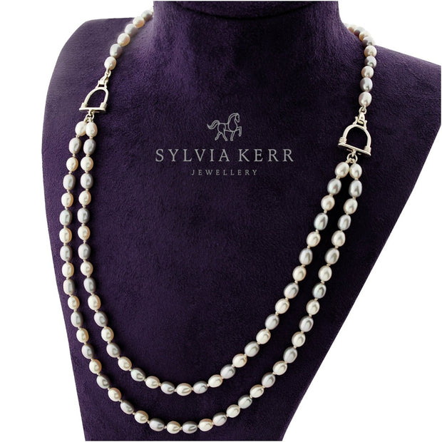 designer double strand of grey and cream pearl with stirrup detail necklace on purplejewellery display bust