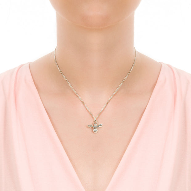 model wearing designer silver carved honey bee necklace