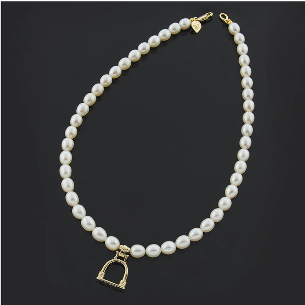 Designer solid 9ct gold vintage stirrup and cultured pearl necklace on black background