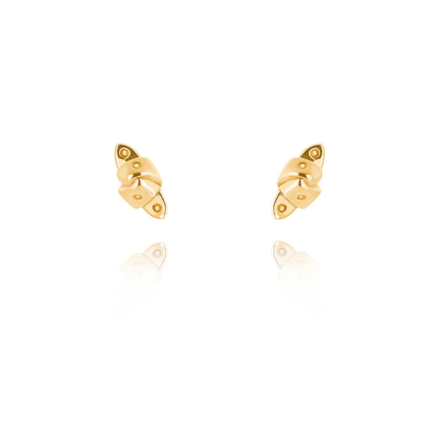 designer gold knotted strap stud earrings on white background.