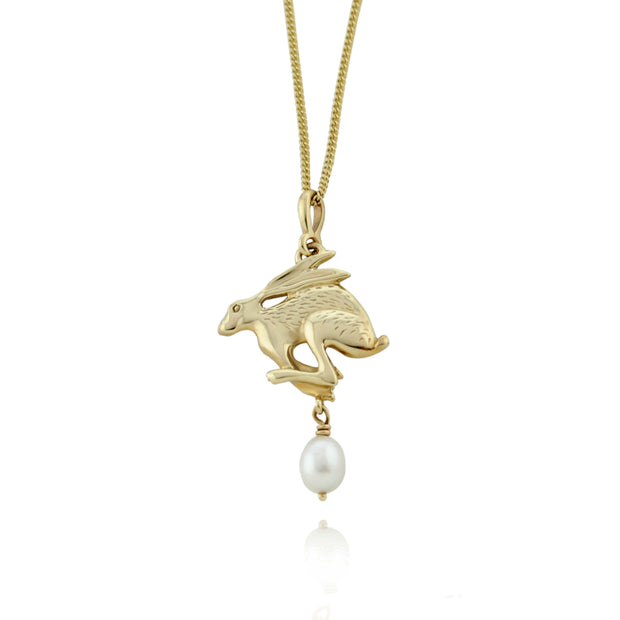 designer solid gold hare necklace with cultured pearl drop.