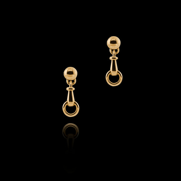 designer solid 9ct yellow gold horse bit inspired drop earrings on black background.