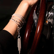 model in Morgan car wearing solid silver equestrian chain tassel with caribiner clip.