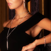model wearing solid sterling silver horsebit and chain longth necklace with matching tassel.