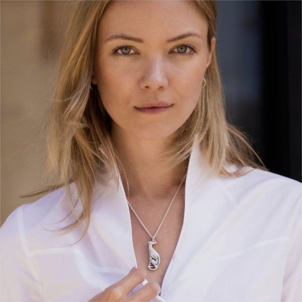 model wearing silver hand carved hound necklace
