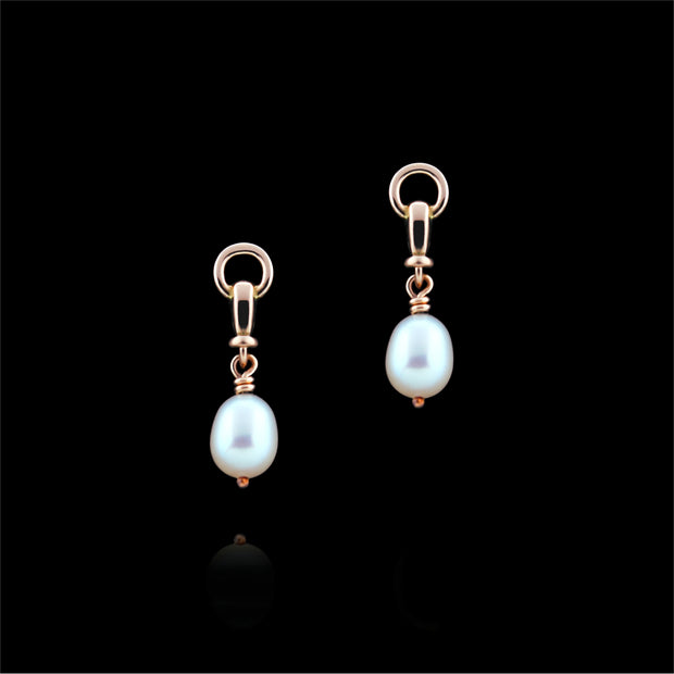designer rose gold and cultured pearl ascot drop earrings on black background