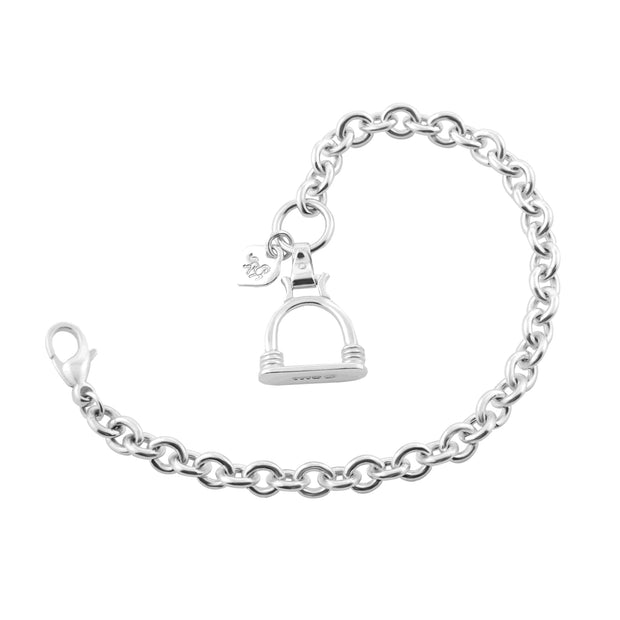Designer solid silver heavy weight chain bracelet with vintage stirrup inspired large charm on white background.