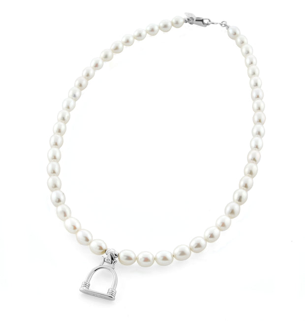 designer cultured pearl necklace with vintage solid silver stirrup design charm on white background.
