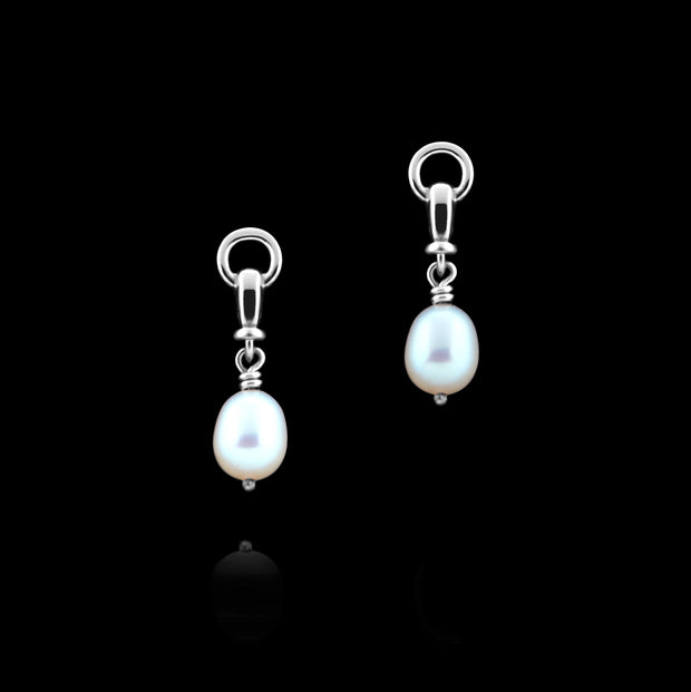 designer solid silver and cultured pearl ascot drop earring on black background.