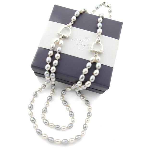 designer double strand of grey and cream pearl with stirrup detail necklace on white background