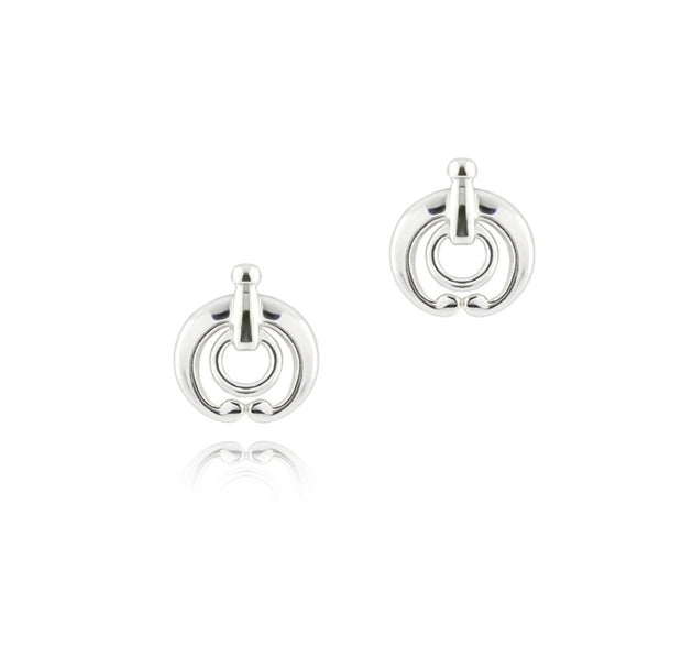 designer silver equestrian stud earrings on white background