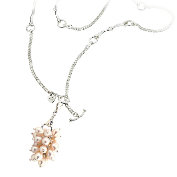 designer silver lariat equestrian bit and chain necklace with cultured pearl bauble on white background