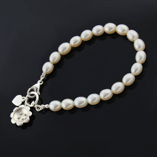 designer silver and pearl bracelet with retro daisy charm