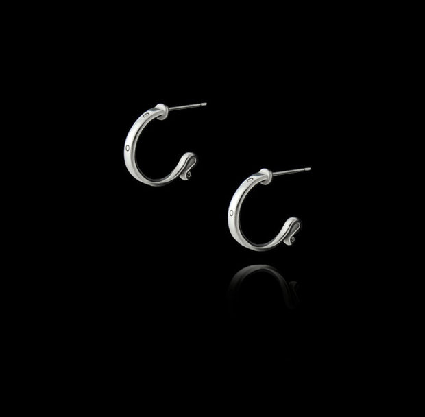 designer solid silver leather strap hoop earrings on black background
