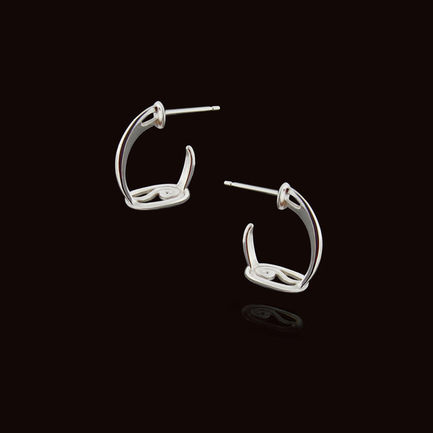 designer solid silver stirrup inspired hoop earrings on a black background.