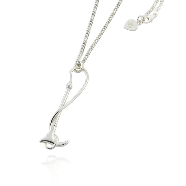 Designer solid silver hunting crop necklace on white background.