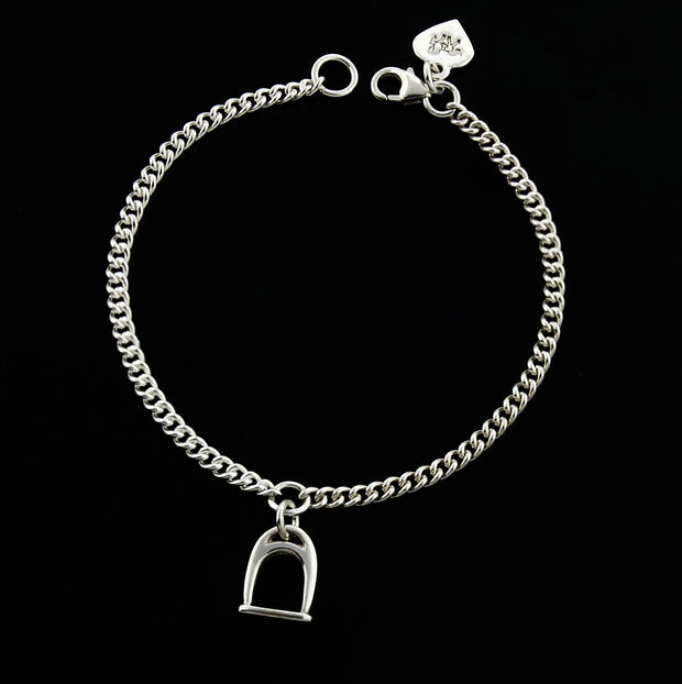 designer  solid silver stirrup and chain bracelet on black  background.