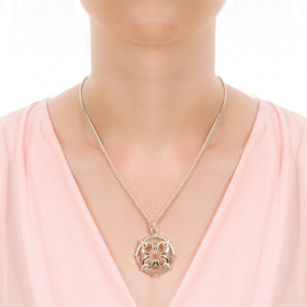 neck shot of model wearing designer silver wrought iron work inspired necklace