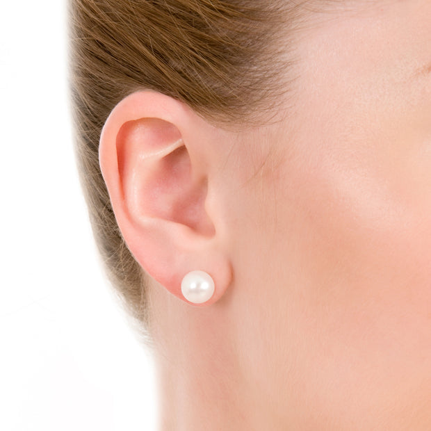 close up of model wearing 9mm button cultured pearl studs with 9ct white gold fittings.