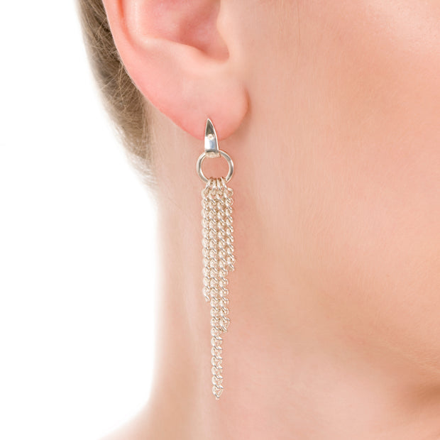 image of model's ear wearing designer solid silver chain equestrian styled drop earrings on white background