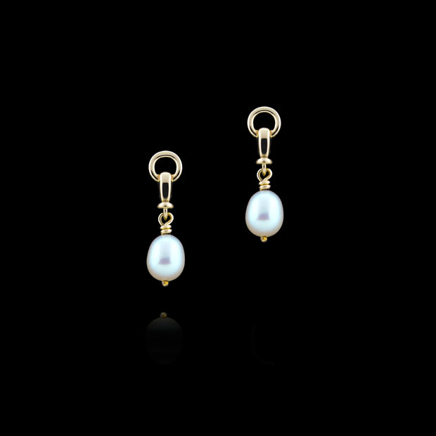 designer gold and cultured pearl ascot drop earrings on black background