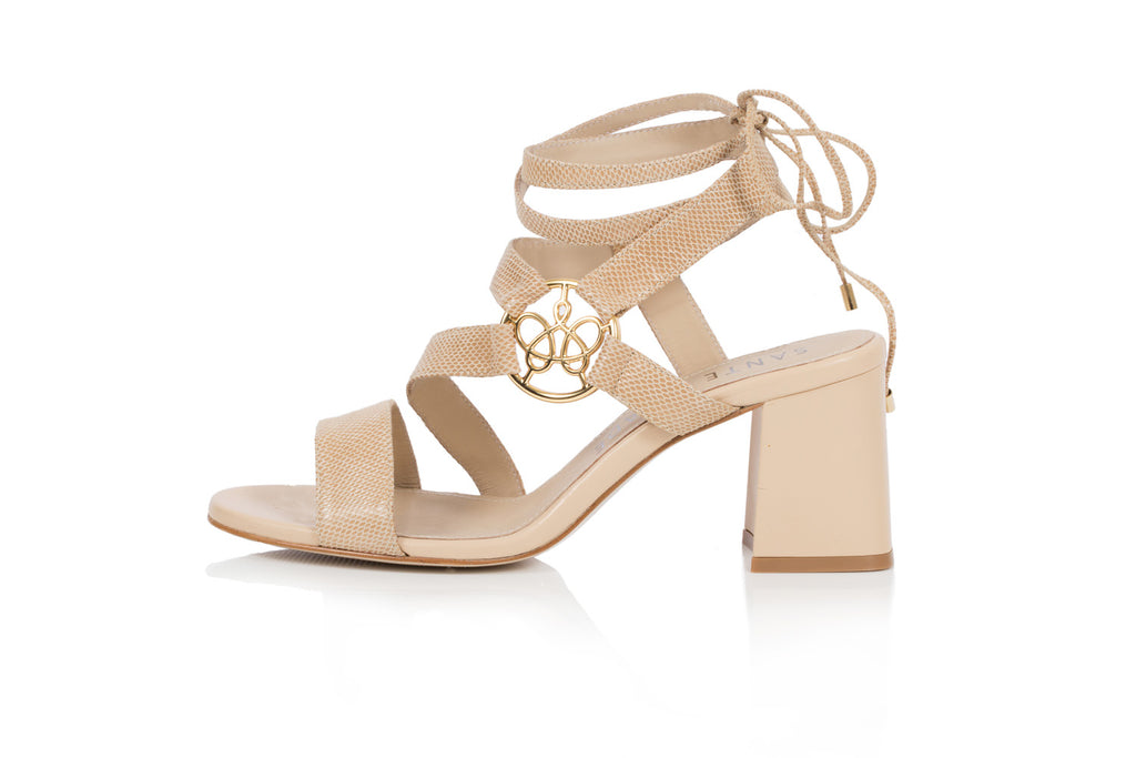 Lara sandal in beige textured leather with asymmetric straps and gold logo ornament, set on 65mm flared block heel