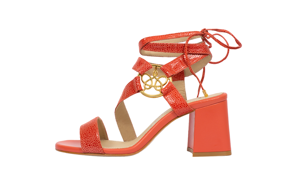 Lara coral embossed leather ankle-tie sandal with asymmetric straps and gold logo ornament, set on 65mm flared block heel