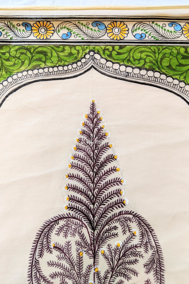 Detailed view of the tree top and border of the Saura painting