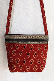 Closer view of the Casual Block Printed Colored Sling Bag in Cinnabar Red