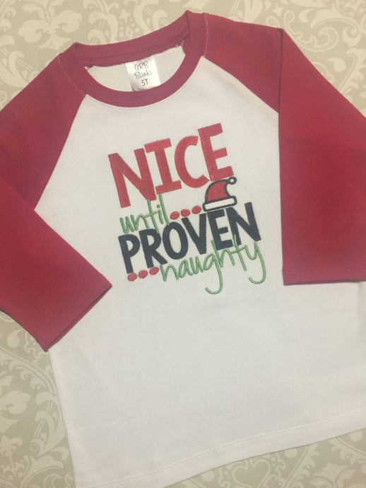 Nice until proven naughty Christmas raglan