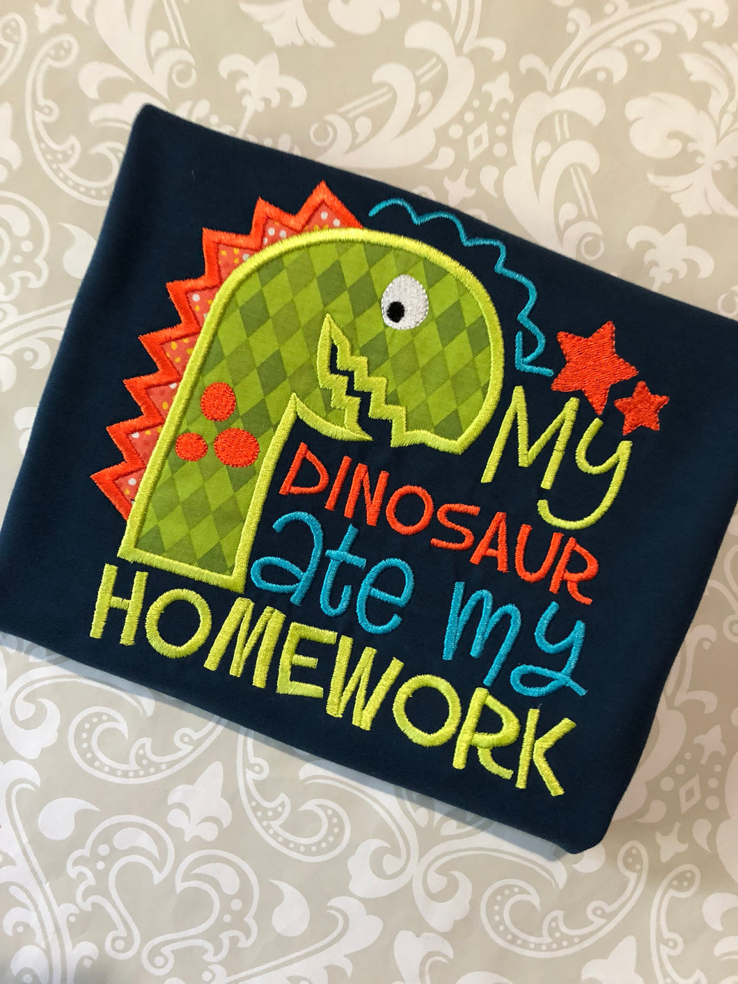 My Dinosaur ate my homework applique School tee