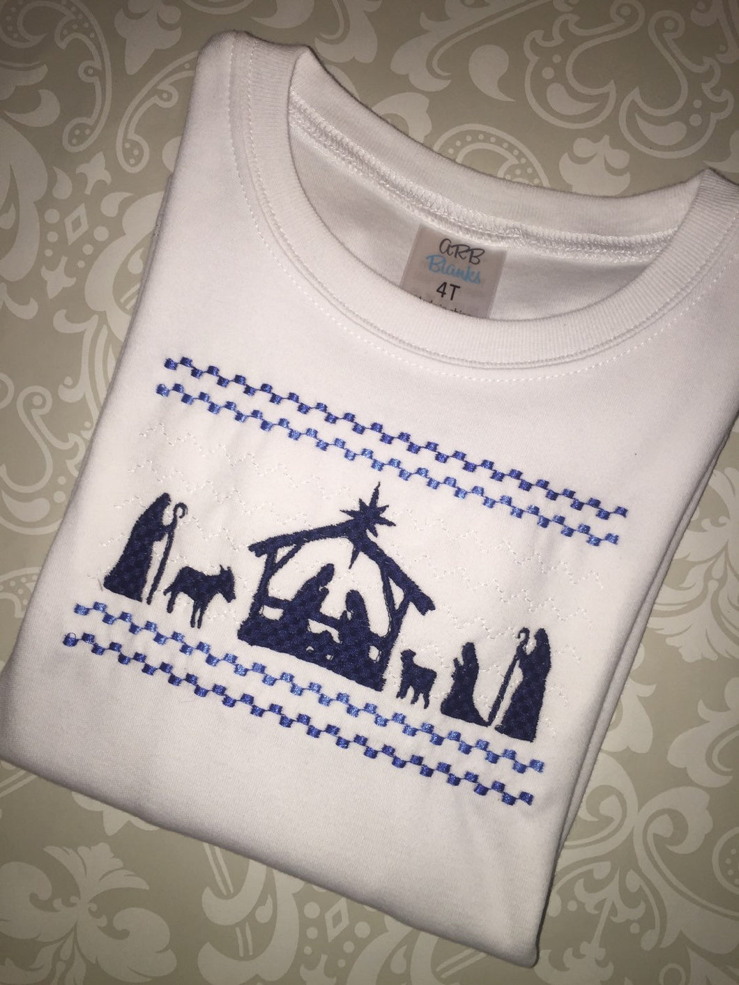 Nativity Faux smocked tee