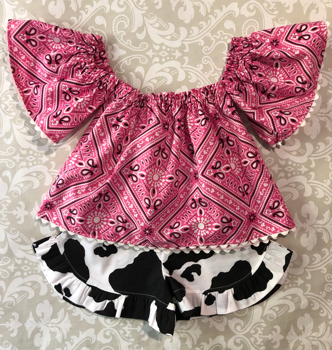 Off the shoulder pink bandanna top with cow print ruffle shorts