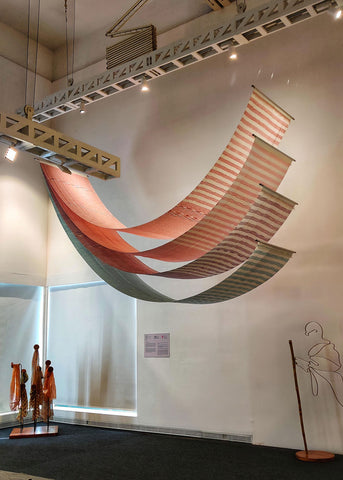 An art installation made of colorful Handspun Khadi Sarees hanging by the roof on the exhibition hall on the eve of Gandhi Jayanti
